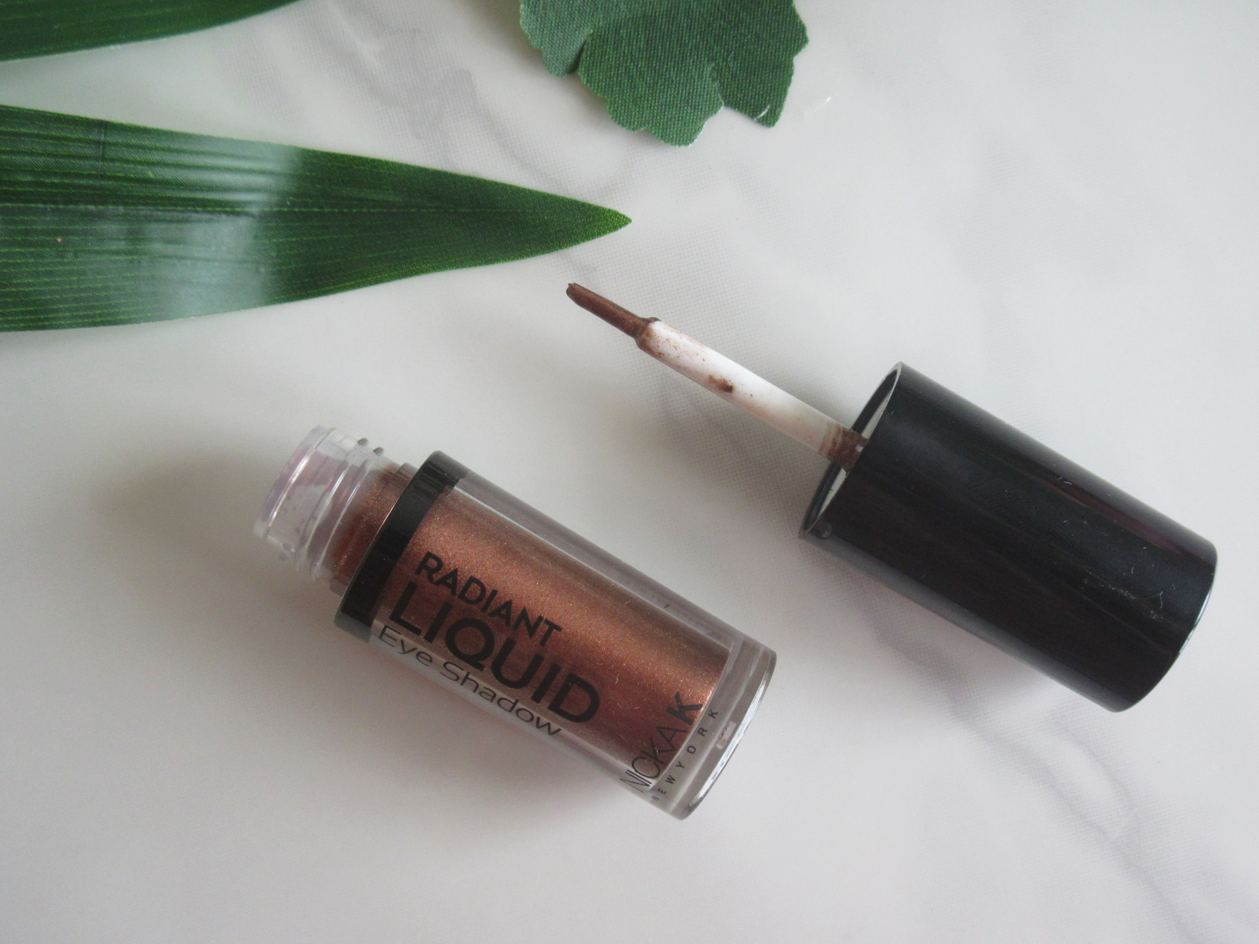 nicka k liquid eyeshadow earthly bronze